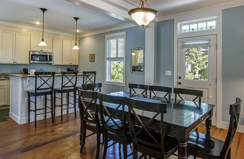 Rental kitchen and dining at Seabrook Cottage Rentals.