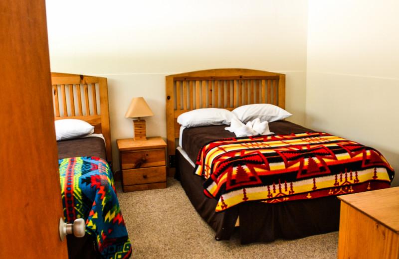 Cabin bedroom at Meeks Bay Resort & Marina.