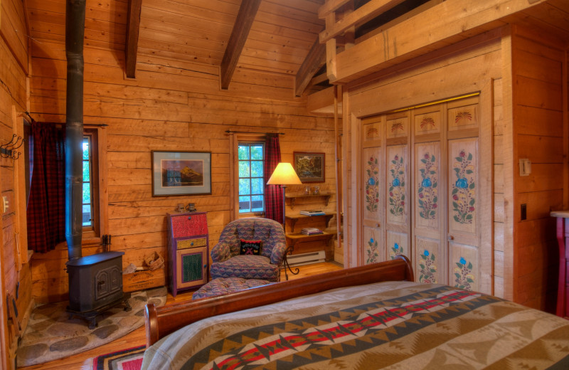Cabin bedroom at The Home Ranch.