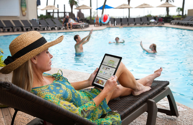Relaxing by the pool at Ocean Reef Resort.