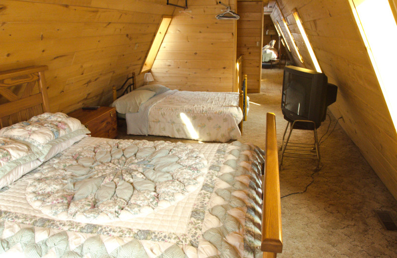 Cabin bedroom at Tri Lake Timbers Resort.
