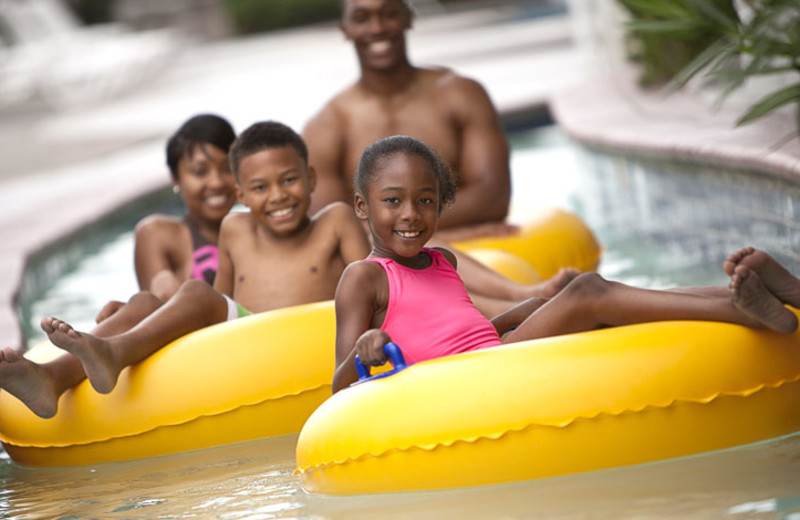 Family on lazy river at Crown Reef Resort.