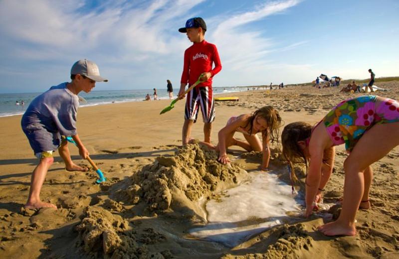Kids Building Sandcastle at Hatteras Realty
