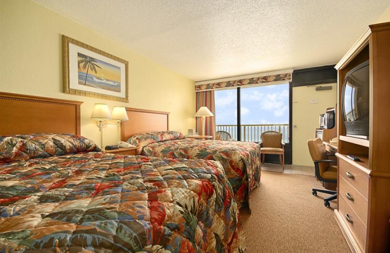 Guest room at Ramada-Plaza Beach Resort.