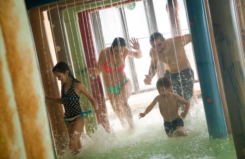 Family at water park at Caribbean Resort & Villas.