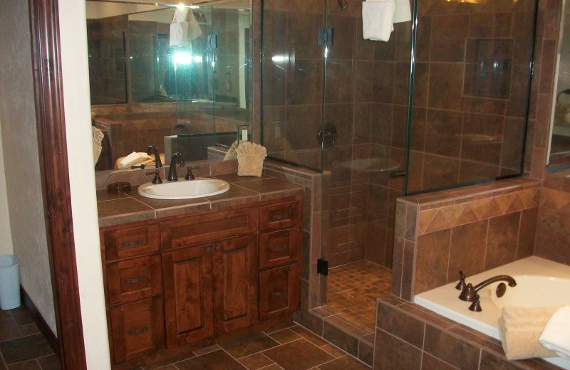 Rental bathroom with hot tub at Sunetha Property Management.