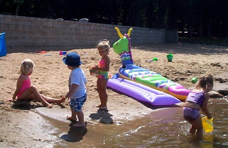 Kids Playing On The Beach At Black Pine Resort