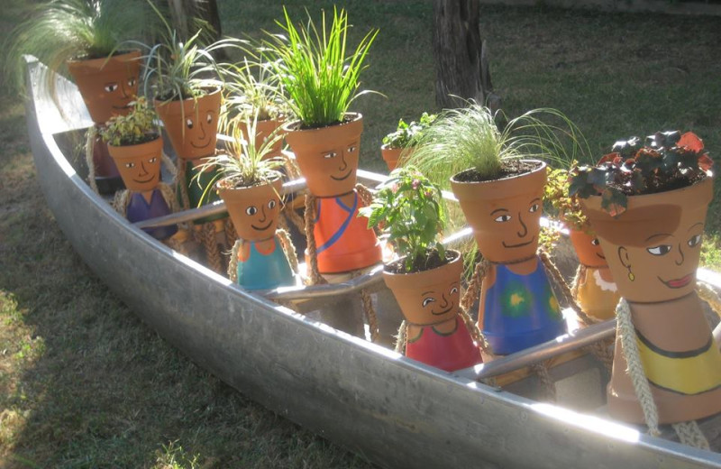 Flower pot people in canoe garden at Cliffview Resort.