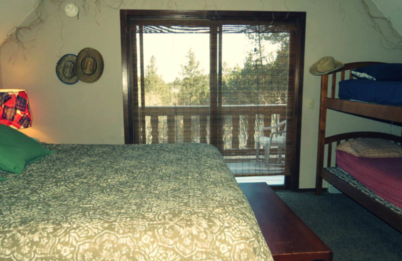 Cabin bedroom at Edelweiss Mountain Lodging.