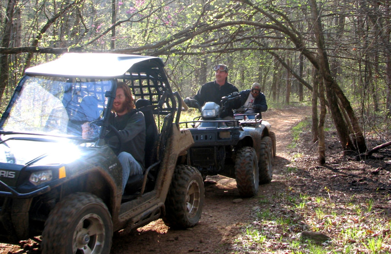ATV through the forest at Mulberry Mountain Lodging & Events.