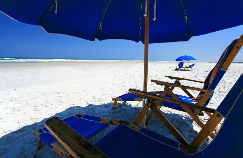 Relax on the beach at Holiday Isle Oceanfront Resort.