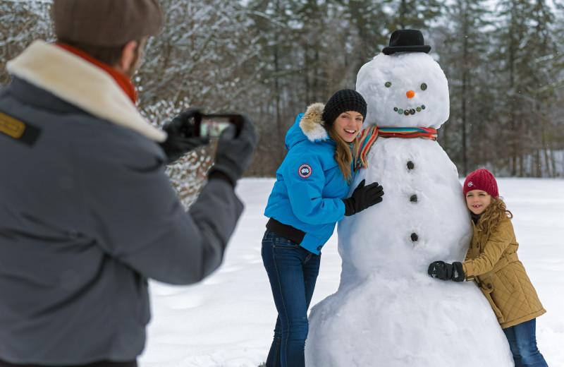 Building a snowman at Fairmont Le Chateau Montebello.