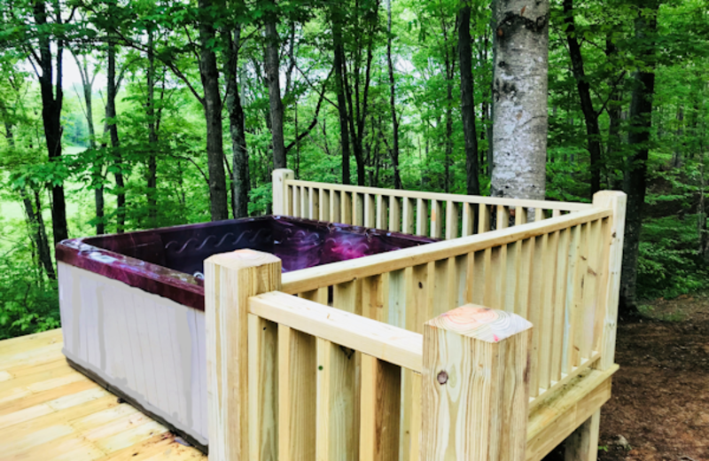 Soak away your worries in this spacious hot tub while listening to the robins sing you a sweet melody