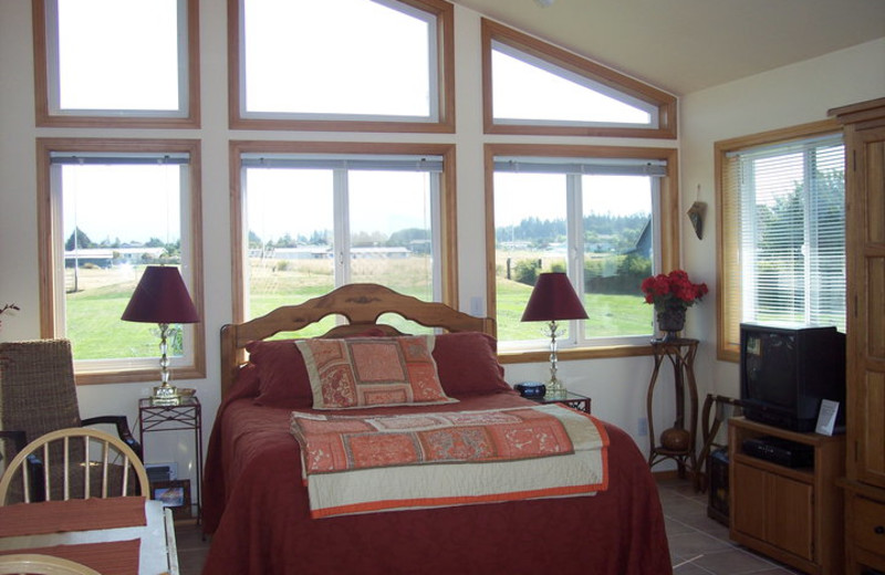 Cottage bedroom at Juan De Fuca Cottages.