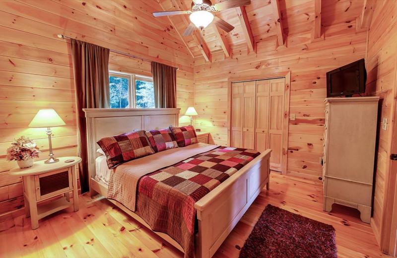 Cabin bedroom at Sliding Rock Cabins.