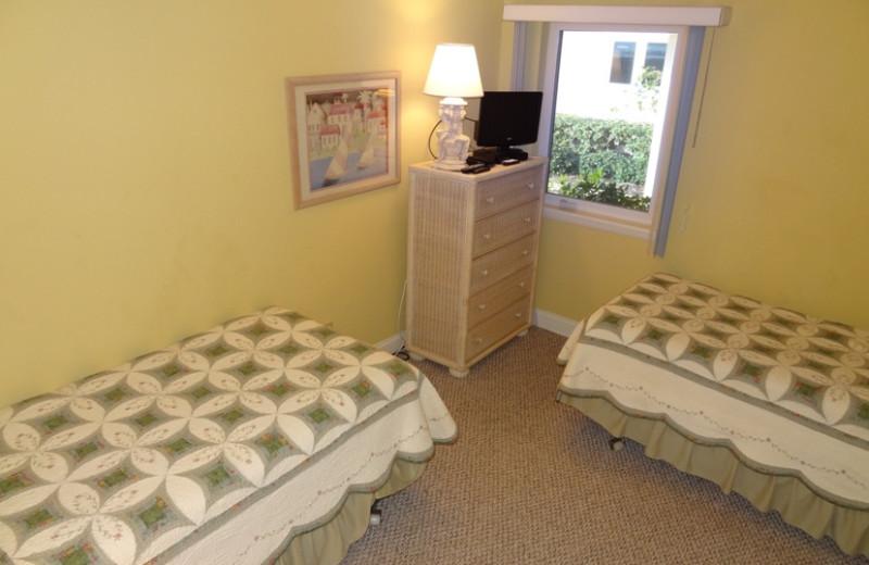 Rental bedroom at Sand Cay Beach Resort.