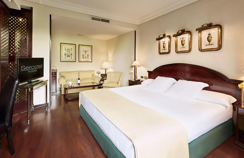 Guest room at Gran Hotel Conde Duque.