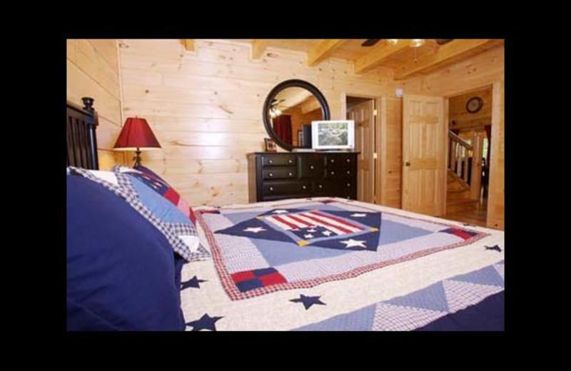 Cabin bedroom at Eden Crest Vacation Rentals, Inc. - American Bear.