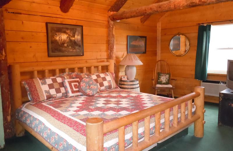 Cabin bedroom at Big Rock Candy Mountain Resort.