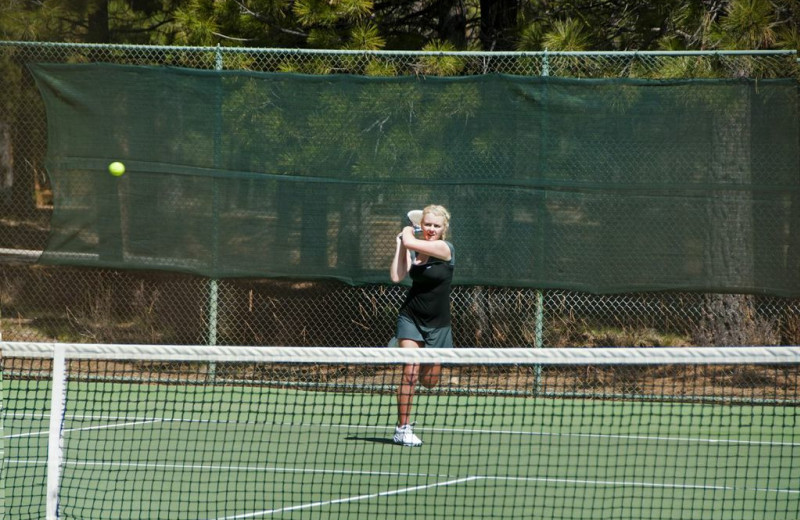 Playing tennis at Black Butte Ranch.