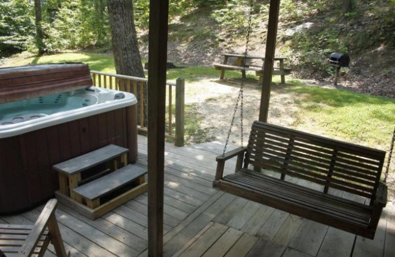 Cabin hot tub and deck at Red River Gorge Cabin Company.