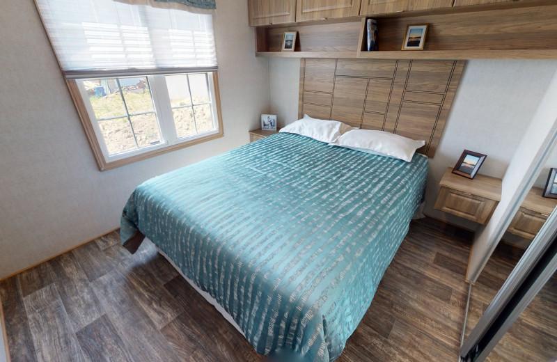 Cottage bedroom at Great Blue Resorts- Shamrock Bay Resort.