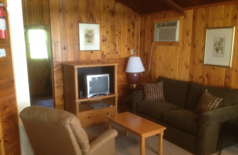 Cabin living room at Whispering Pines Resort.