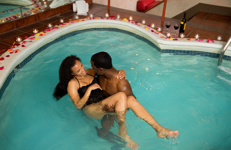 Couple in pool at Cove Haven Entertainment Resorts.