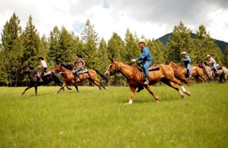 Horseback riding at Laughing Water Ranch.