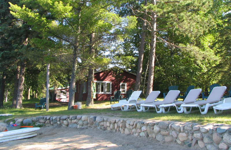 Lounge chairs by the beach at Two Inlets Resort.