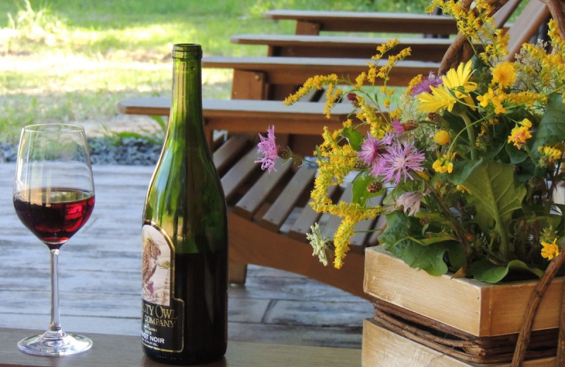 Wine on porch at Cayuga Lake Cabins.