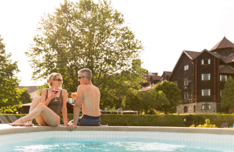 Couple by the pool at Fairmont Le Chateau Montebello.