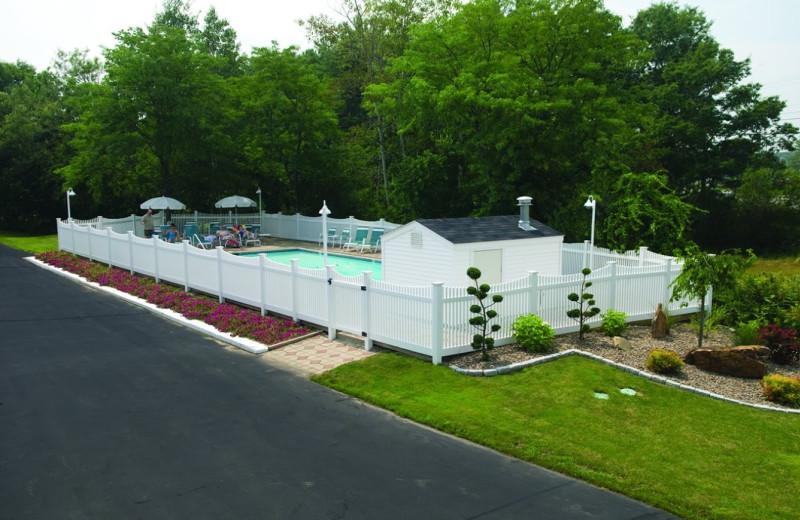 Outdoor pool at Coachman Inn.