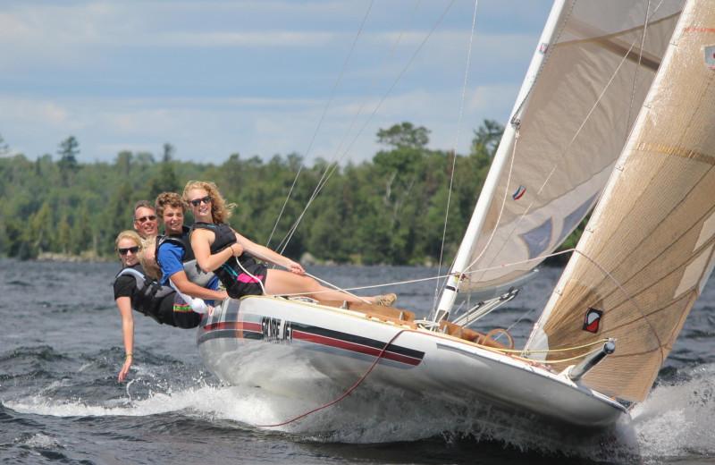 Hanson family sailing across Lake Vermilion.