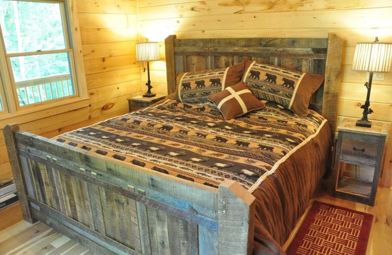 Cabin bedroom at Great Smokys Cabin Rentals.