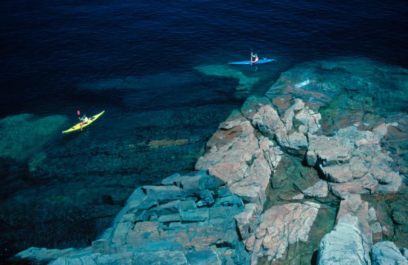 Kayaking a long the shore at Aqua Log Cabin Resort.