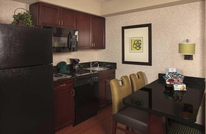 Suite kitchen at Homewood Suites by Hilton Dallas Market Center.