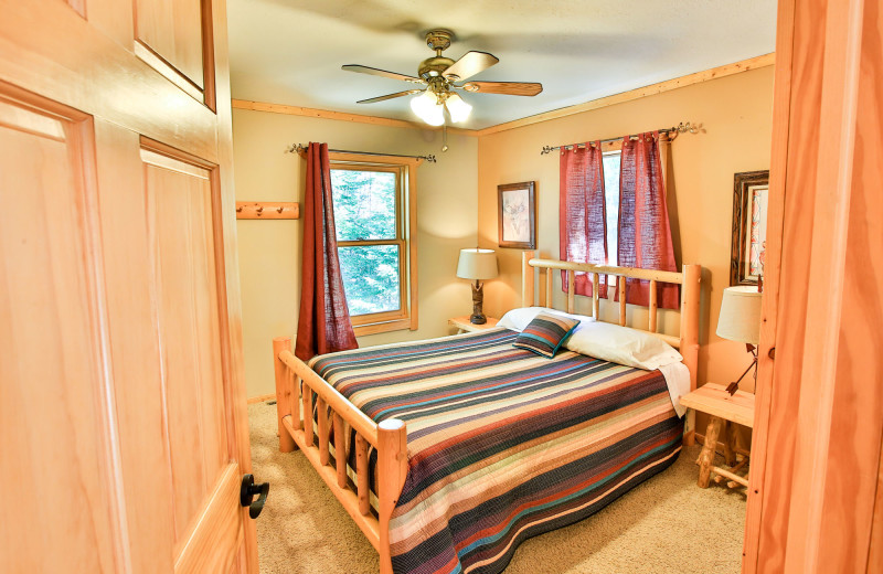 Cabin bedroom at Northern Lights Resort & Outfitting.