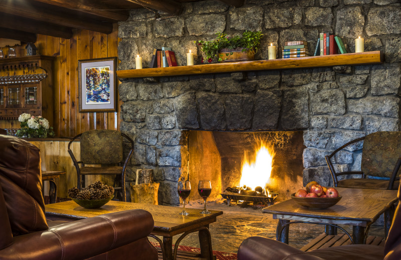 The Lobby at Garnet Hill Lodge with it's warm and inviting fireplace is a great place for guests to relax and meet new friends.