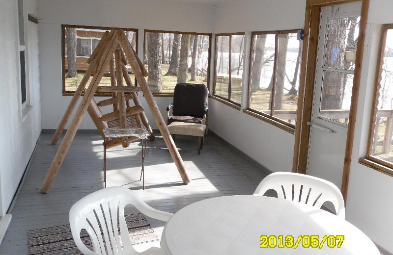 Cabin porch at Red School Resort.