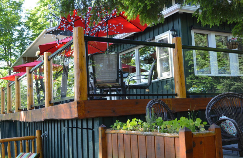 Dining patio overlooking the lake offers a spectacular setting for meals at Heather Lodge.