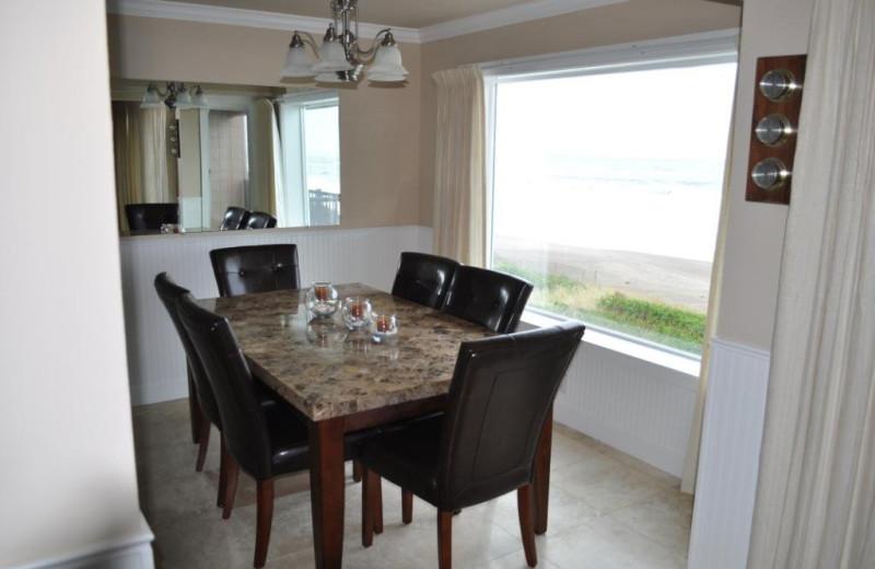 Unit 21 dining room at Cavalier Beachfront Condominiums.