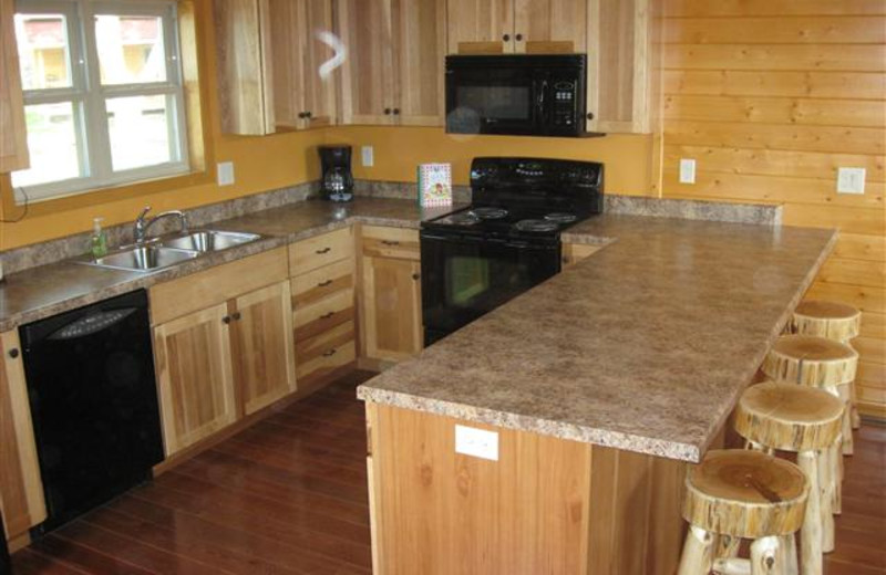 Sunrise Ridge Cabin Kitchen has full size appliances and stocked with all kitchen essentials.