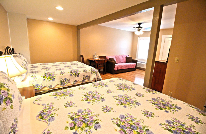 Guest bedroom at Peach Tree Inn & Suites.