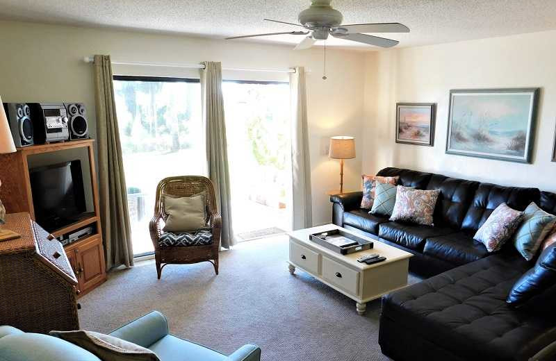 Rental living room at Family Sun Vacation Rentals.