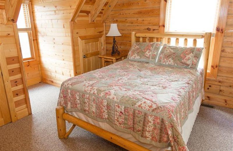 Cabin bedroom at SmokyMountains.com.