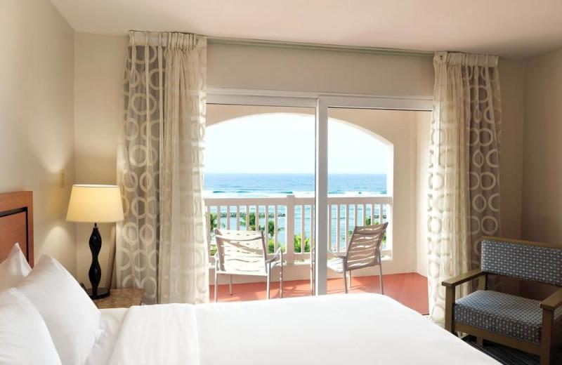 Guest room at Embassy Suites Dorado del Mar.