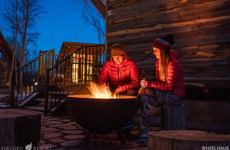 Couple by the fire at Fireside Resort at Jackson Hole.
