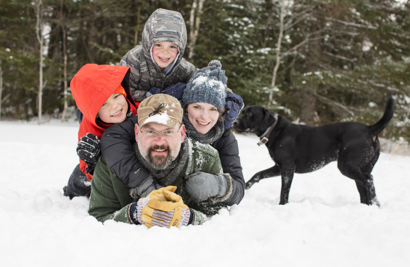 Families play in the snow at Skyport Lodge