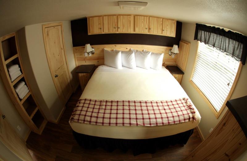 Cottage bedroom at Hill Country RV Resort & Cottage Rentals.